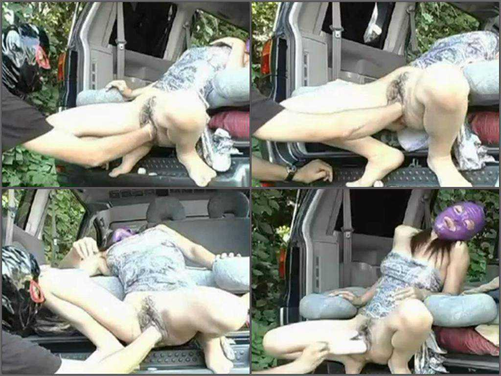 Asian masked couple elite fisting outdoor