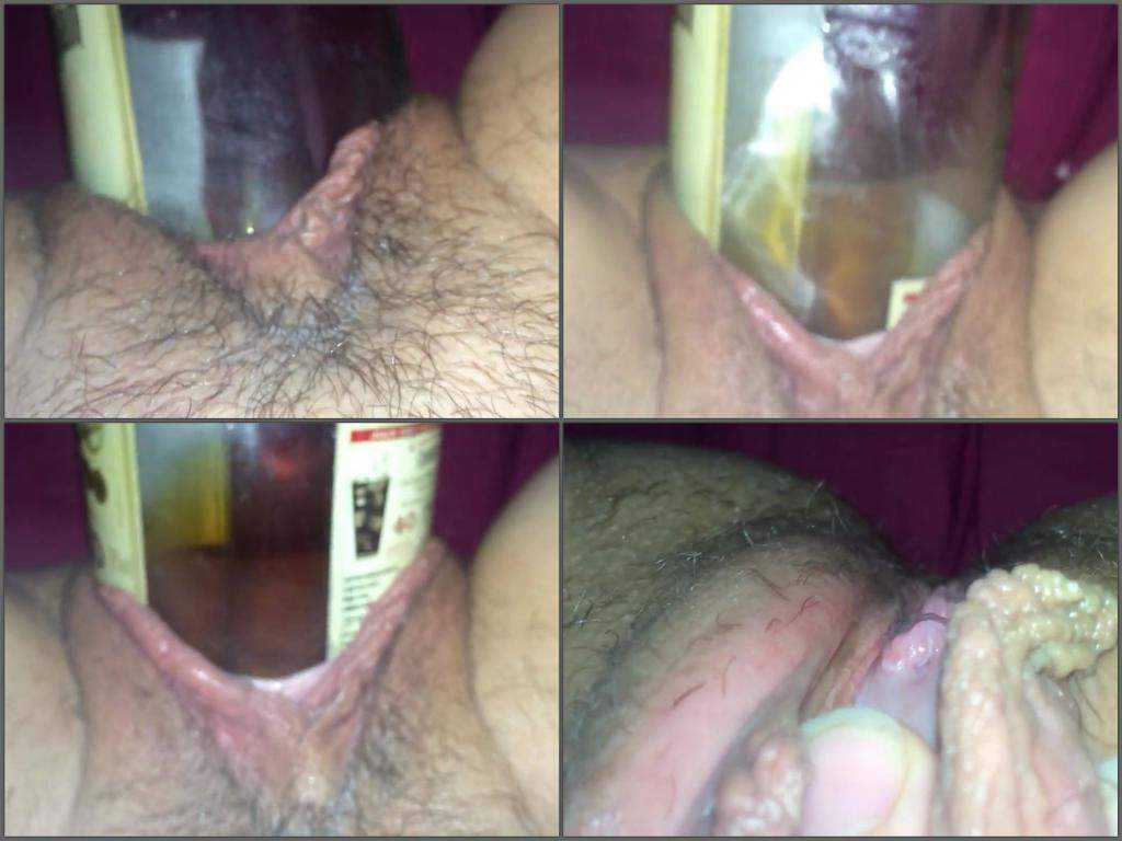 Bottle of rum penetrated deep in hairy pussy