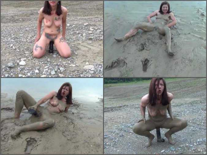 Dirty girl with mud on her body dildo rides