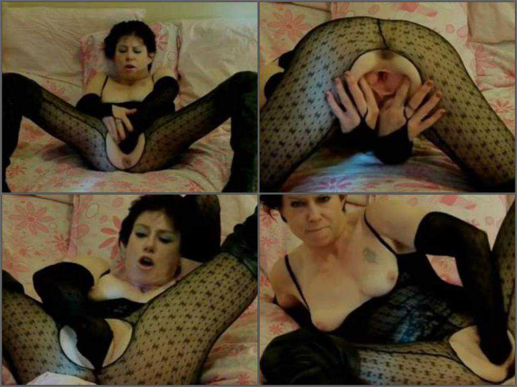 Mature wearing nylon suit and fisted herself