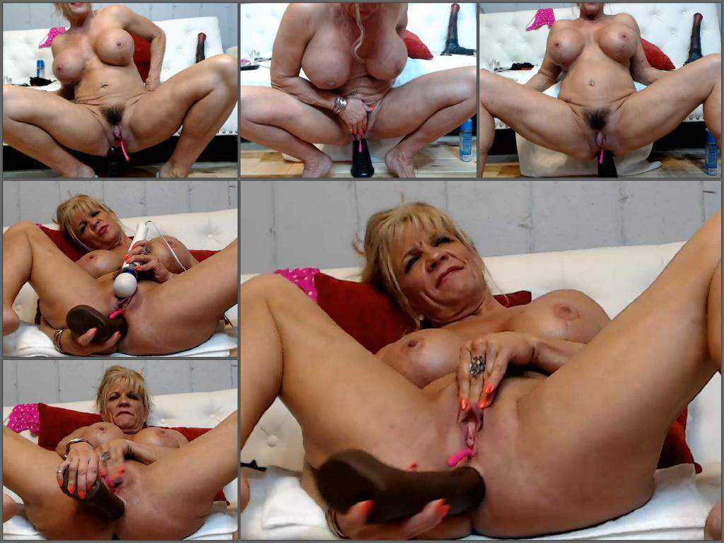 Busty muscular mature with huge clit solo rides on a big dildo